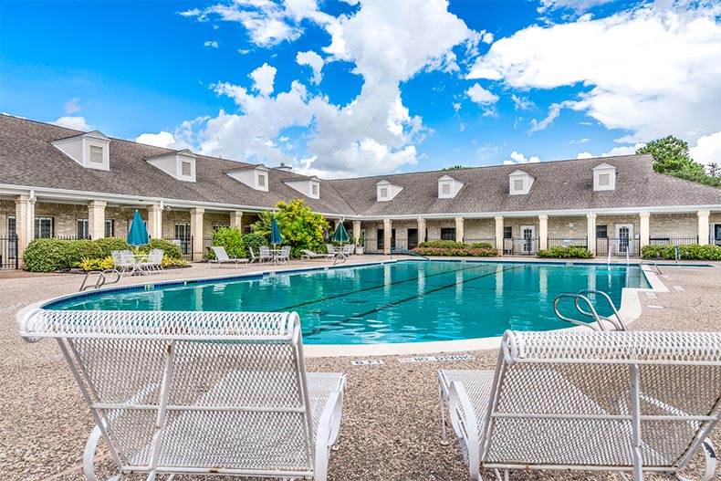 Lounge chairs beside the outdoor pool at CountryPlace in Pearland, Texas