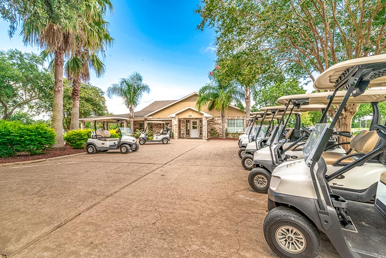 Golf carts lined up outside the golf course entrance at CountryPlace in Pearland, Texas