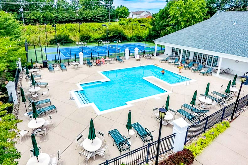 View of the outdoor pool and tennis court at CrossRidge in Glen Allen, Virginia