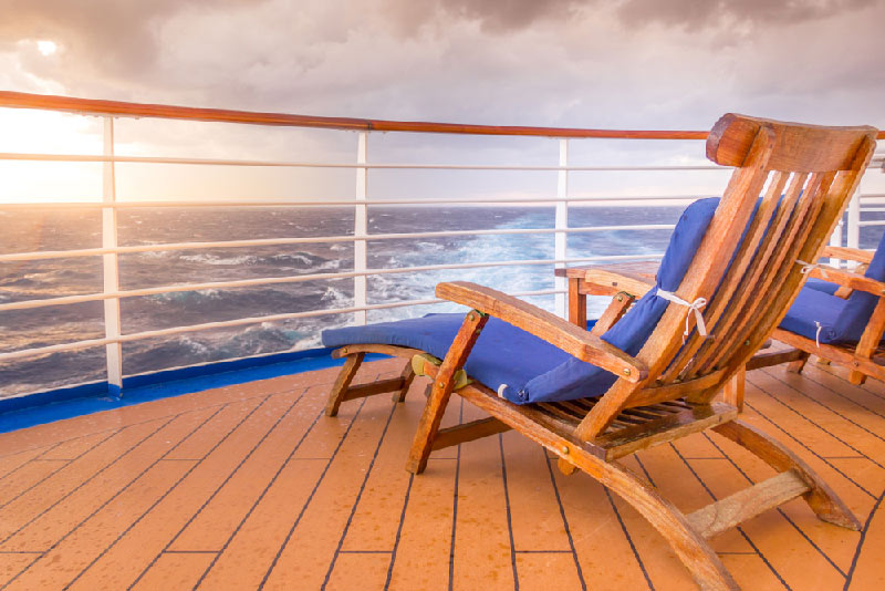 relaxing chair on deck of cruise ship facing the ocean
