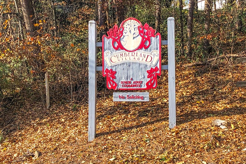 Fall foliage surrounding the community sign for Cumberland Village in Hendersonville, North Carolina