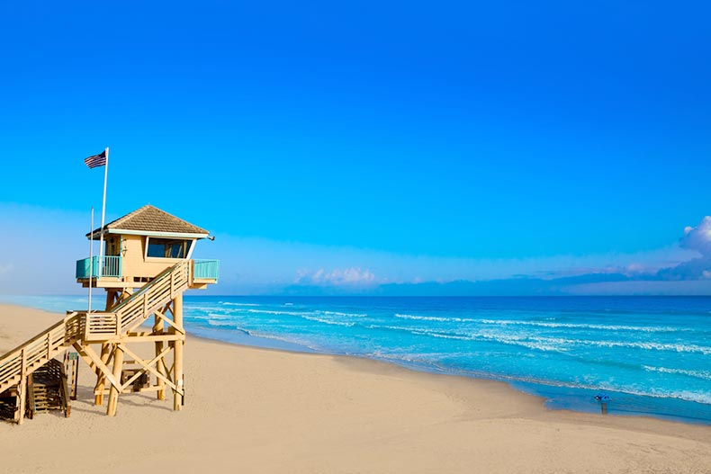 A blue sky over a baywatch tower on the shore of Daytona Beach in Florida