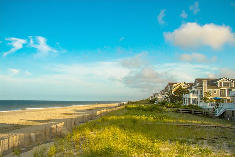 Blue sky over a row of houses along the shore of Bethany Beach in Delaware
