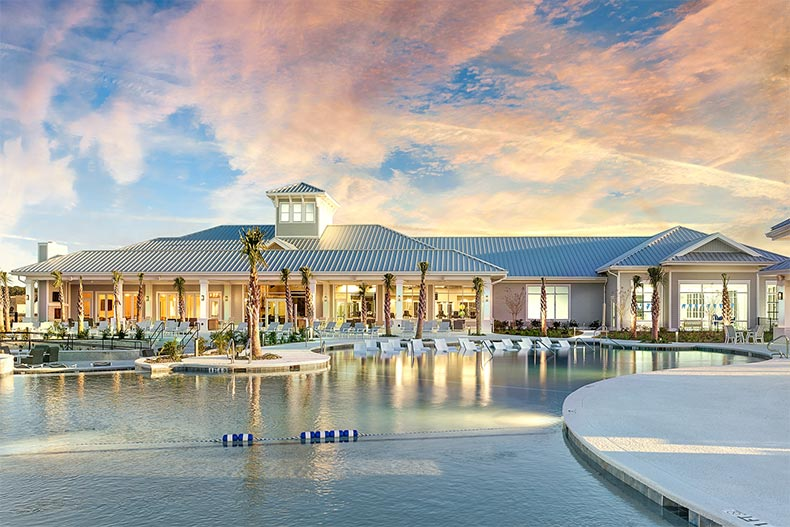 Exterior view of the clubhouse and resort-style pool at Del Webb at Grande Dunes Myrtle Beach in Myrtle Beach, South Carolina