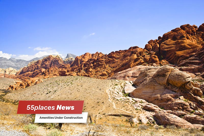 """55places News: Amenities Under Construction"" banner over a desert landscape in North Las Vegas, Nevada"