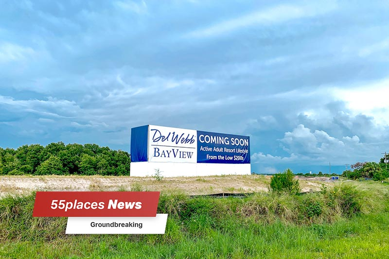 """55places News: Groundbreaking"" banner over the ""coming soon"" community sign for Del Webb BayView in Palmetto, Florida"