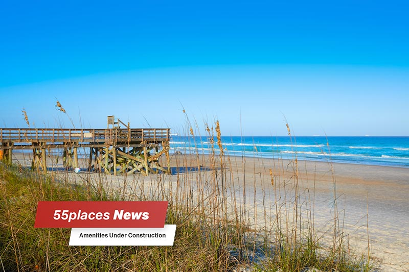 """55places News: Amenities Under Construction"" banner over an Atlantic Beach in Jacksonville, Florida"