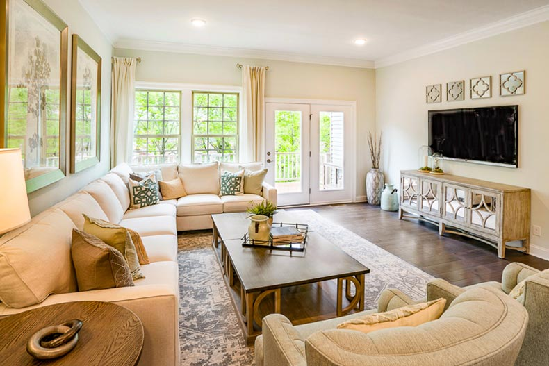 Interior view of a living room in a model home in Del Webb Florham Park in Florham Park, New Jersey