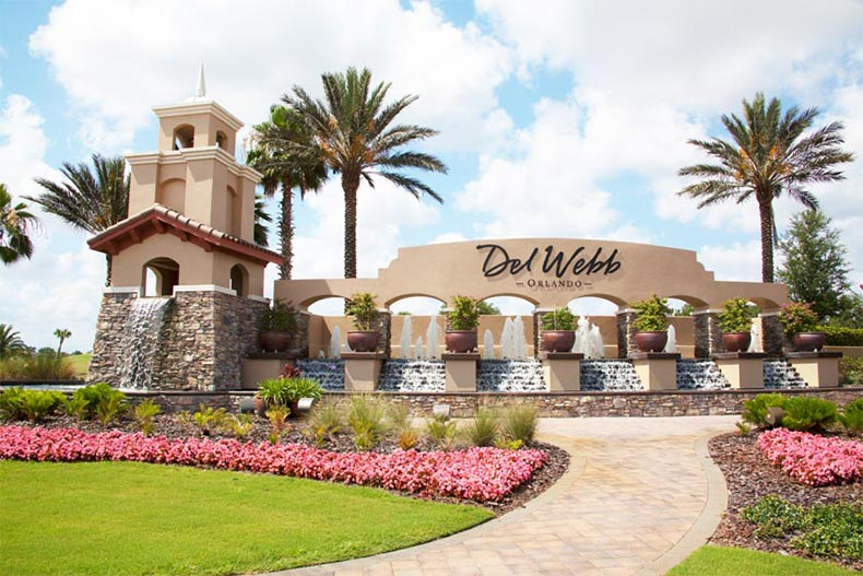 The community entrance sign and water feature at Del Webb Orlando in Davenport, Florida