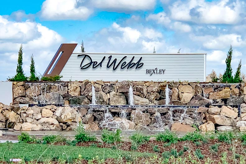 Blue sky with clouds over the sign for Del Webb Bexley in Land O'Lakes, Florida