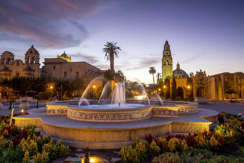 fountain and plaza with buildings at twilight in san diego