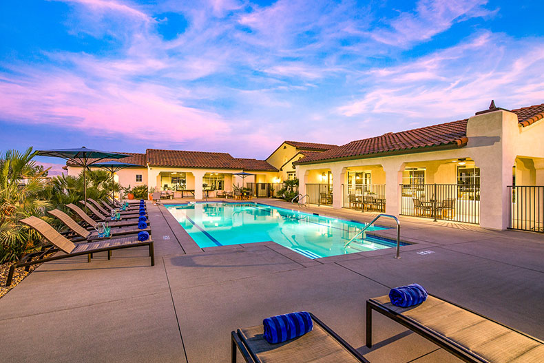View of the pool and clubhouse at Domani in Palm Desert, California.
