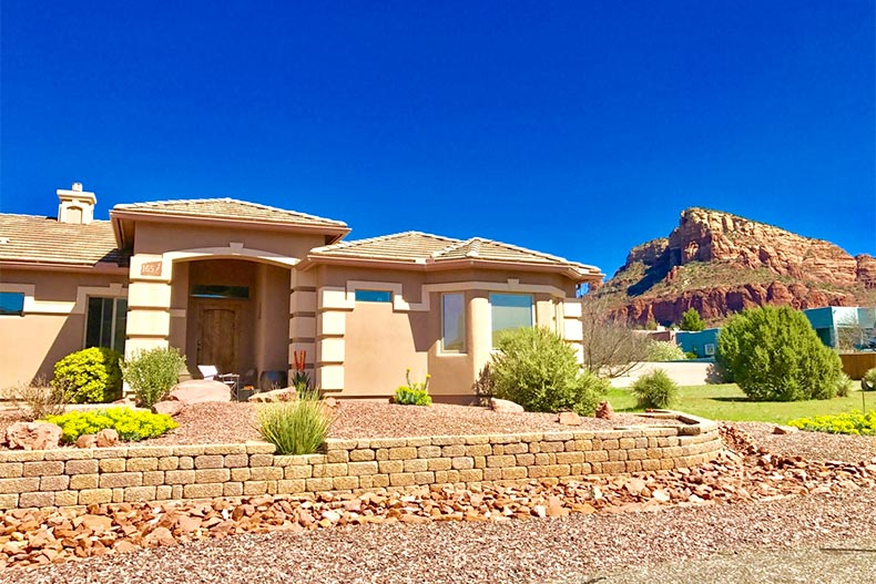 Southwestern-style ranch home with desert mountain in background