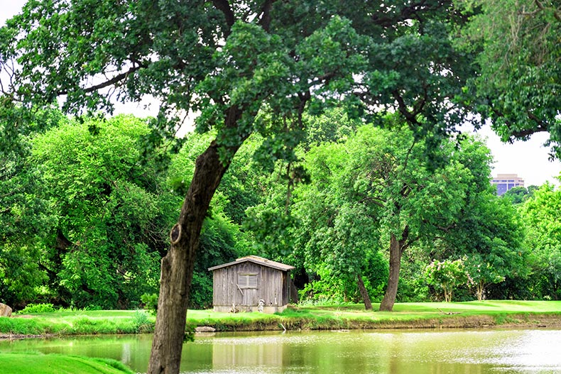 Photo of a wooden house on a lake in a large garden in Dallas, Texas