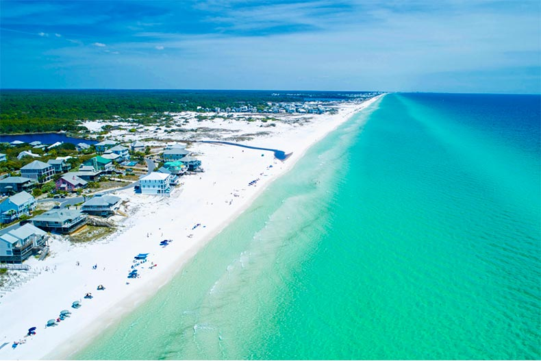 Aerial view of green water and white sand on Drayton Beach in Florida