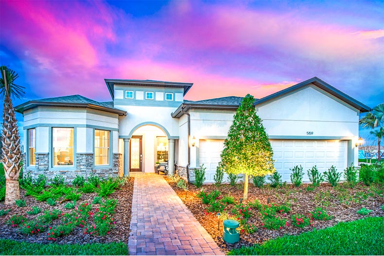 Exterior of model home in Del Webb Bexley at sunset
