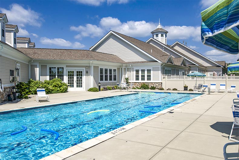 Outdoor pool and clubhouse in Del Webb Chauncy Lakes, MA