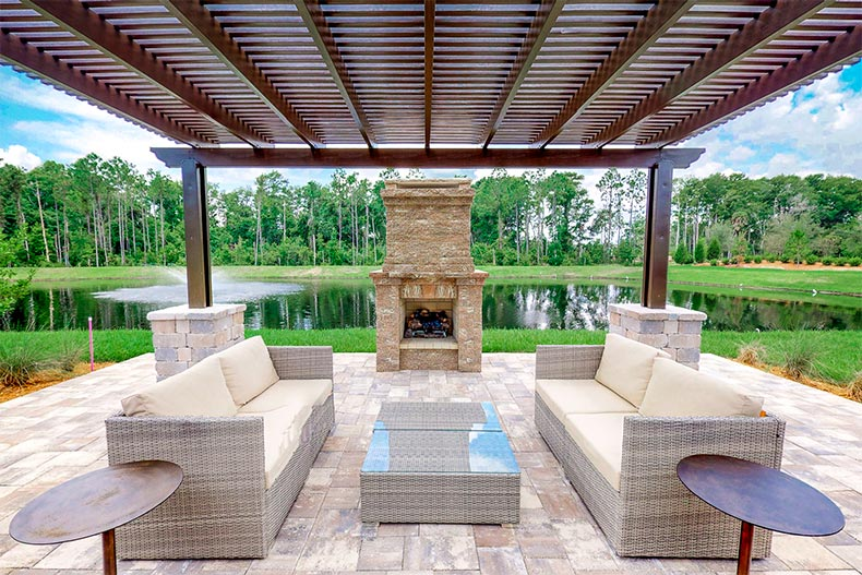 Covered patio with fireplace in Del Webb Nocatee, Ponte Vedra, FL