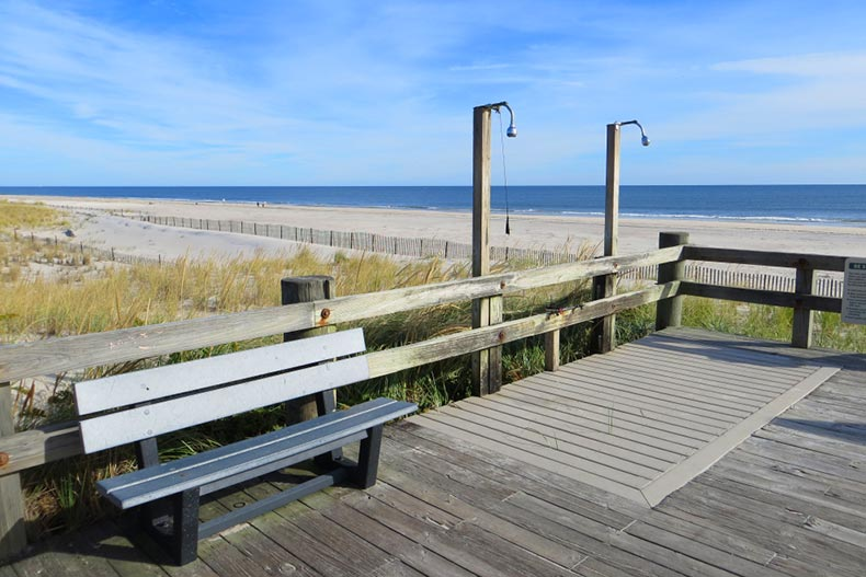 A bench and showers on the boardwalk at Westhampton Beach in Long Island, New York