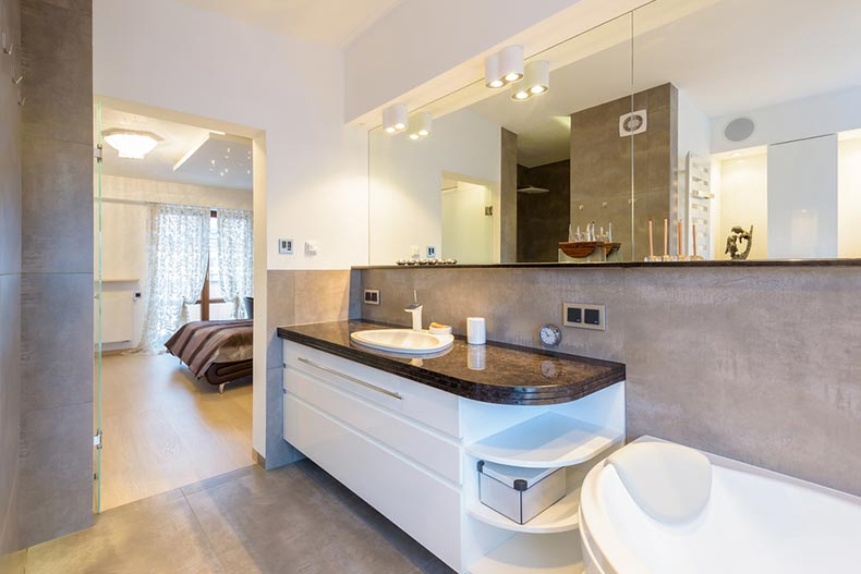 A modern en suite bathroom in a new luxury home