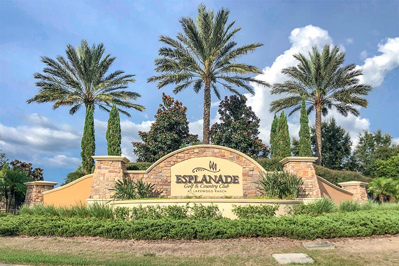 Palm trees behind the community sign for Esplanade at Lakewood Ranch in Lakewood Ranch, Florida
