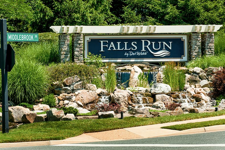 A water feature in front of the sign for Falls Run in Fredericksburg, Virginia