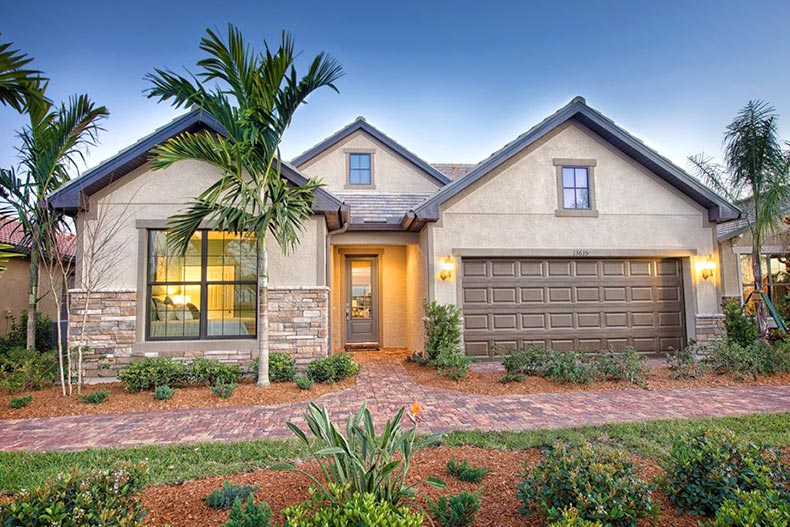 Exterior view of a model home at Del Webb Naples in Ave Maria, Florida