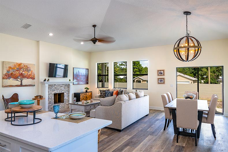 Interior view of the dining and living area in a model home at American Village in Palm Coast, Florida