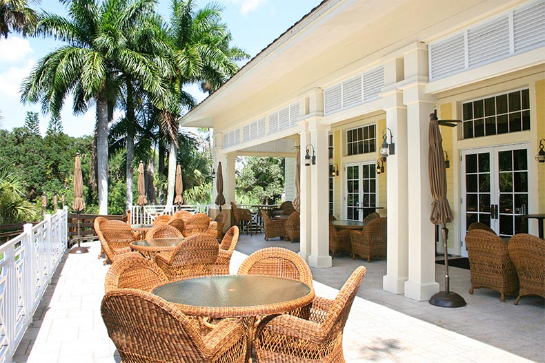 Dining tables on the outdoor patio at Verandah in Fort Myers, Florida