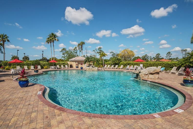 A blue sky over the outdoor pool at Heron Creek in North Port, Florida