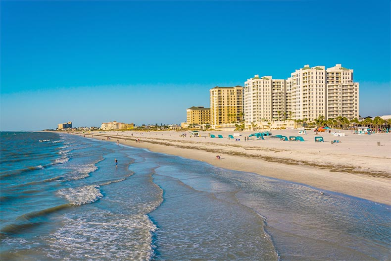 View of a blue sky and beachfront hotels along the shoreline in Clearwater Beach, Florida