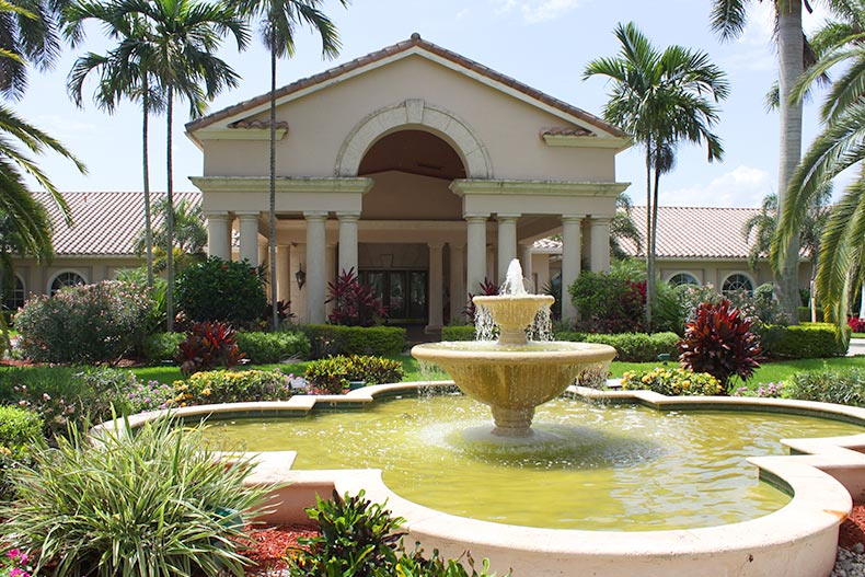 View of the fountain and greenery outside the clubhouse at The Cascades in Boynton Beach, Florida