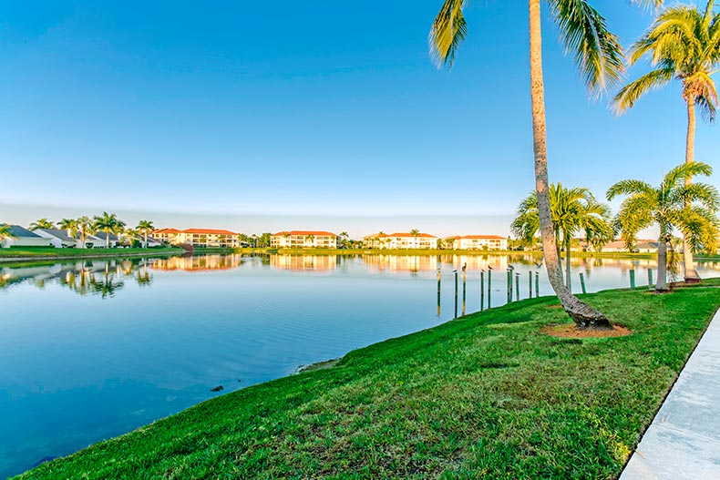 View of condo buildings across the fishing lake at Cinnamon Cove in Fort Myers, Florida