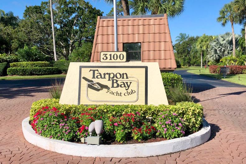 Greenery surrounding the community sign at Tarpon Bay Yacht Club in Port St Lucie, Florida