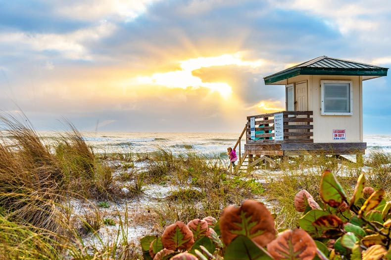 Sunset view of the lifeguard tower on Lido Key Beach in Sarasota, Florida