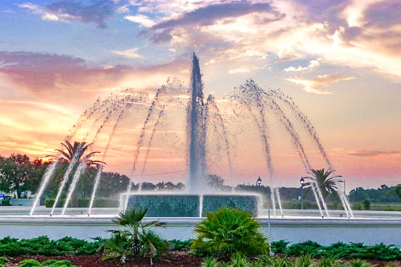 A sunset view of the fountain at the community entrance at Spruce Creek Country Club in Summerfield, Florida