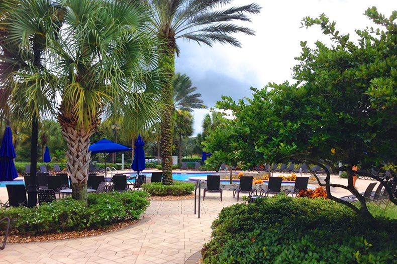 View of the outdoor pool and patio at Pelican Preserve in Fort Myers, Florida