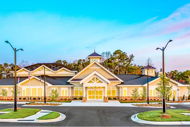 Exterior view of the clubhouse at sunset at Del Webb Tradition in Port St. Lucie, Florida