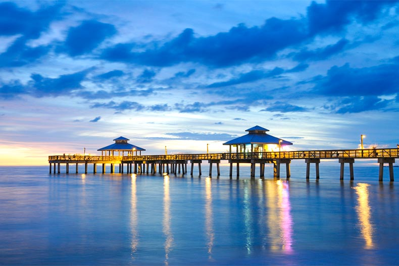 Pier over water during dusk in Fort Myers, FL