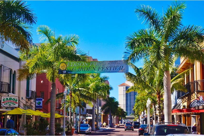 Palm tree-lined streets in downtown Fort Myers on a clear day