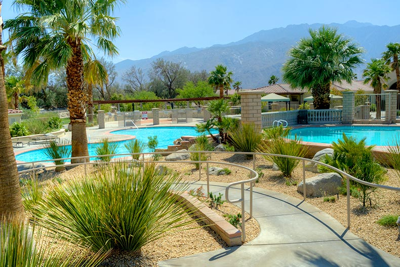 Outdoor pool and desert landscaping at Four Seasons at Palm Springs in Palm Springs, California