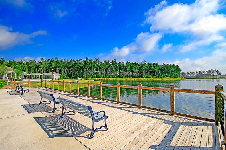 View from a deck onto lake and forested area on a clear day in Four Seasons at The Lakes of Cane Bay