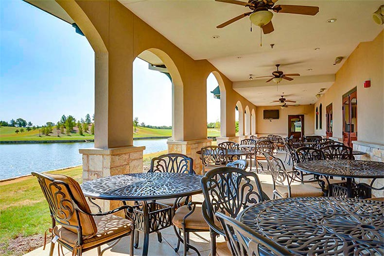 Tables and chairs on an outdoor patio at Frisco Lakes in Frisco, Texas