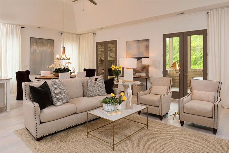 Interior view of a living room in model home at The Overlook at Old Atlanta in Suwanee, Georgia