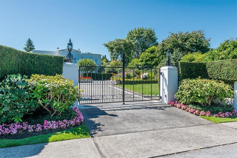 Picturesque landscaping surrounding a closed community gate