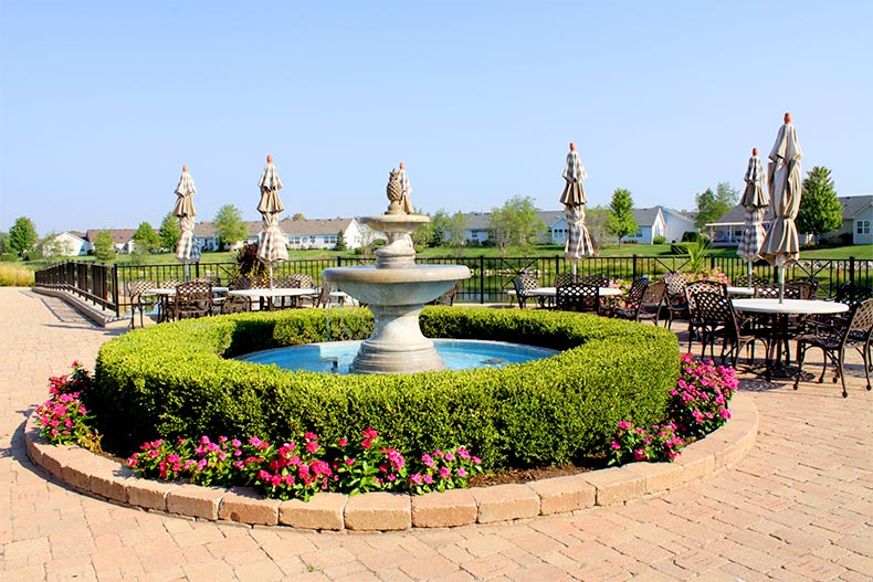 Landscaping in bloom around a fountain on a patio at Grand Haven in Romeoville, Illinois