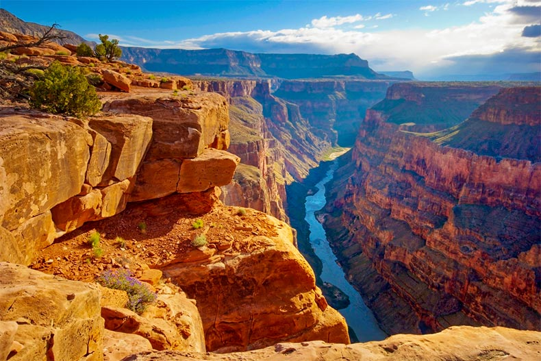 A blue sky over a ravine running through the Grand Canyon in Arizona