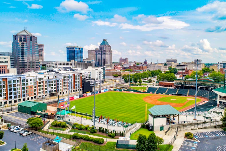 Blue sky over a baseball stadium in Downtown Greensboro, North Carolina with part of the skyline in the background
