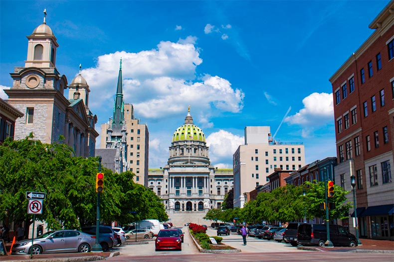 The state capital building of Pennsylvania surrounded by historic builds in Harrisburg