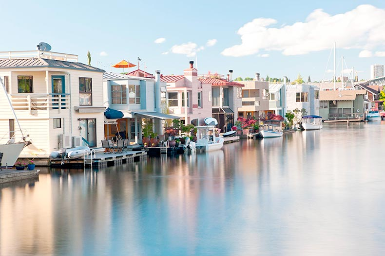 A row of colorful houseboats on the water